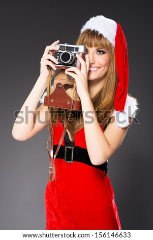 portrait of a santa woman with a old camera
