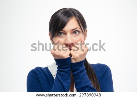 Portrait of a scared businesswoman looking at camera isolated on a white background