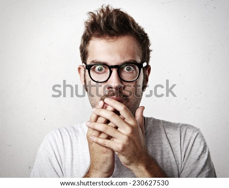 Portrait of a scared young man - stock photo