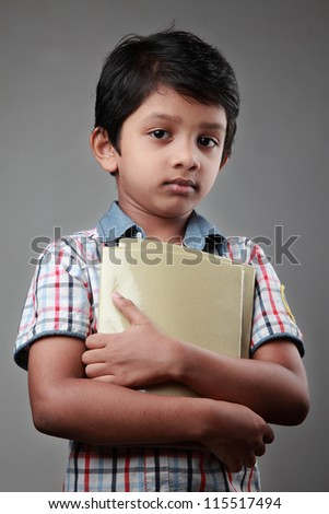 Portrait of a school boy holding his note books
