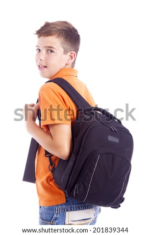 Portrait of a school boy with backpack holding a notebook, isolated on white background - stock photo