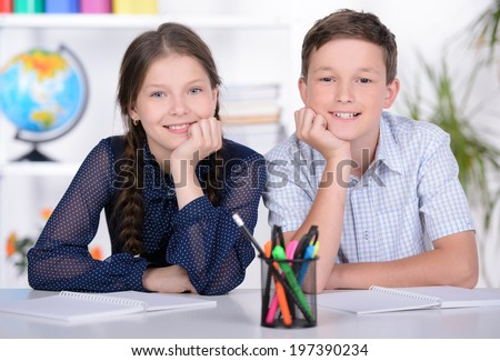 Portrait of a school child, making learning during lesson at school - stock photo