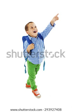 Portrait of a schoolboy with backpack is pointing up. Isolated on white background - stock photo
