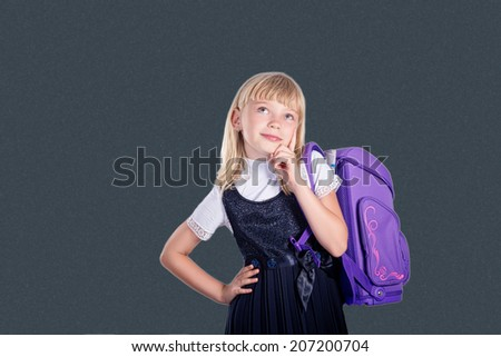 Portrait of a schoolchild on a background of the board. School and education - stock photo