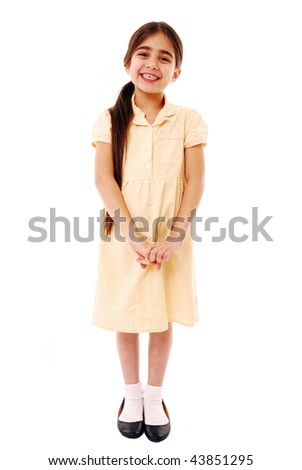 Portrait of a schoolgirl dressed in summer uniform isolated on white