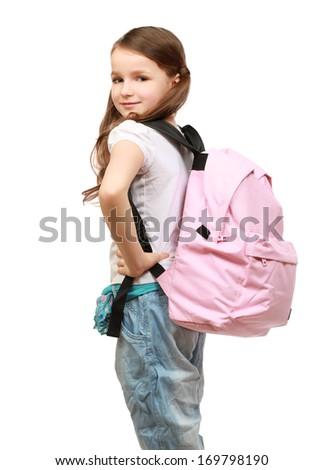 portrait of a schoolgirl looking back over her shoulder - stock photo