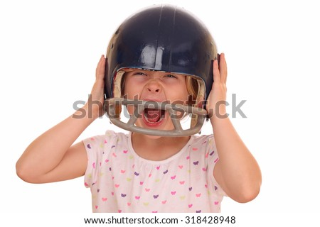 Portrait of a screaming young girl with football helmet on white background - stock photo