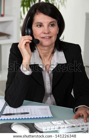 Portrait of a secretary busy at work - stock photo