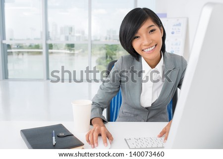 Portrait of a secretary networking at office