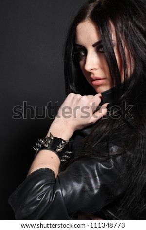Portrait of a seductive caucasian woman in  a black leather jacket