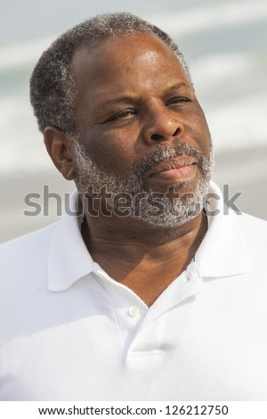 Portrait of a senior African American man in his sixties at the beach - stock photo