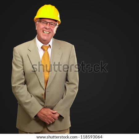 Portrait Of A Senior Architect Isolated On Black Background - stock photo