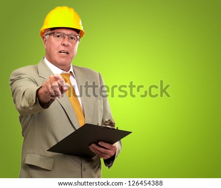 Portrait Of A Senior Architect Isolated On Green Background - stock photo