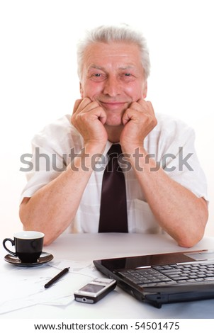 Portrait of a senior business man sitting by laptop - stock photo