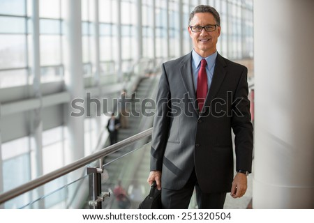 Portrait of a senior businessman at the subway station  - stock photo