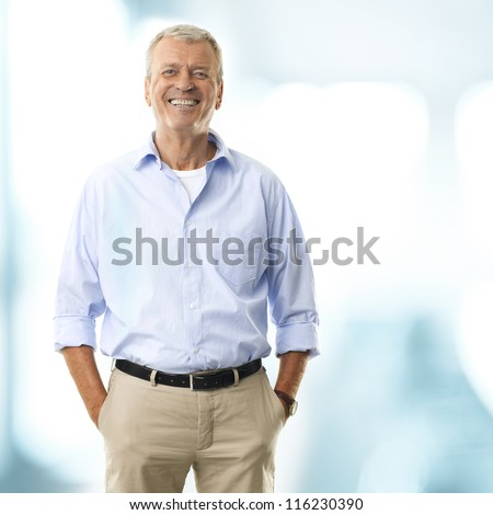 Portrait of a senior businessman smiling in his office - stock photo
