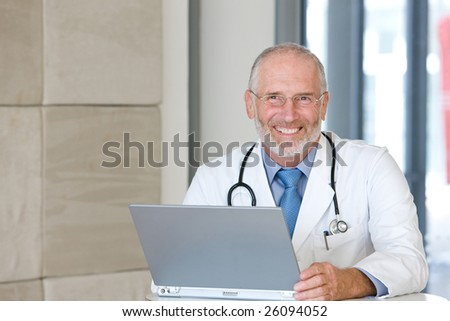 Portrait of a  senior caring doctor - stock photo