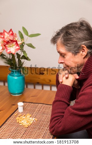 portrait of a senior citizen with medications - stock photo