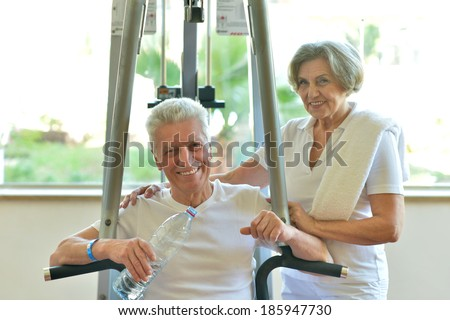 Portrait Of A Senior Couple Exercising In gym - stock photo