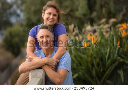 Portrait of a senior couple hugging each other - stock photo