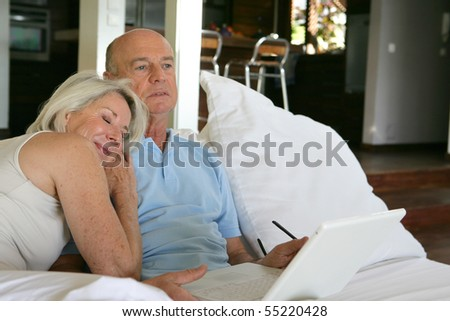 Portrait of a senior couple in front of a laptop computer