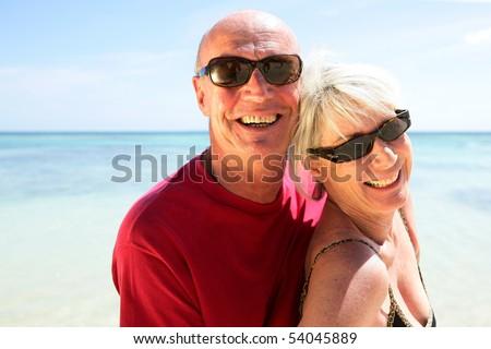 Portrait of a senior couple on the beach - stock photo