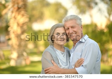 Portrait of a senior couple relaxing near  hotel resort - stock photo