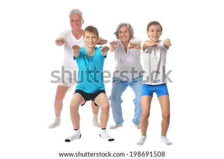 Portrait Of A Senior Couple with two boys Exercising on White Background