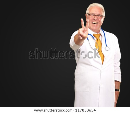 Portrait Of A Senior Doctor On Black Background - stock photo