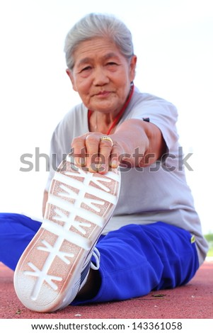 Portrait of a senior doing exercises - stock photo