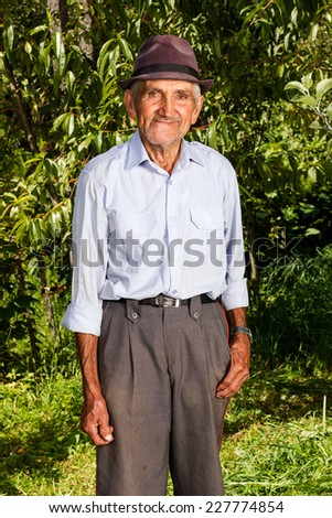 Portrait of a senior farmer outdoor - stock photo