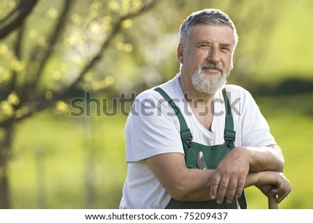 portrait of a senior gardener in his orchard/garden