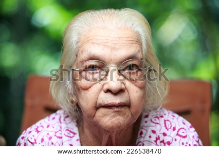 Portrait of a senior Indian woman in outdoor - stock photo