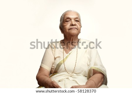 Portrait of a senior Indian woman wearing traditional white dress