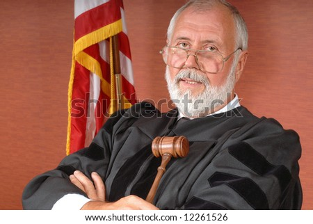 Portrait of a senior judge with an American flag and expendable copy space to both sides