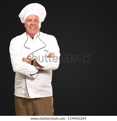 Portrait Of A Senior Male Chef On Black Background - stock photo