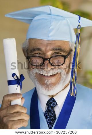 Portrait of a senior male graduate holding certificate - stock photo