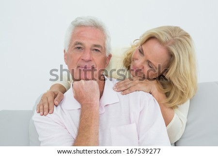 Portrait of a senior man and woman in living room at home