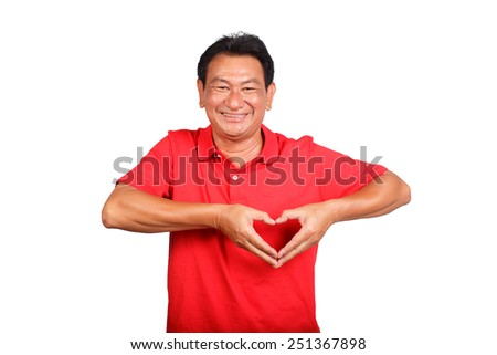 portrait of a senior man doing a heart gesture against a white background - stock photo