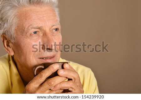 Portrait of a senior man drinking cup of coffee