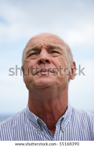 Portrait of a senior man looking away