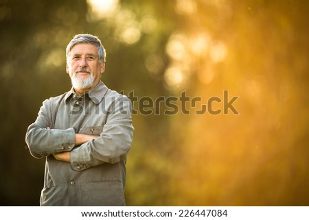 Portrait of a senior man outdoors - stock photo