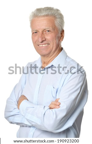 Portrait of a senior man posing on white background