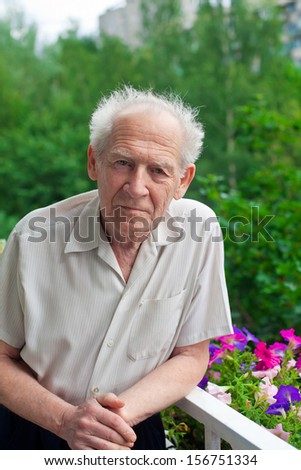 portrait of a senior man standing outside - stock photo