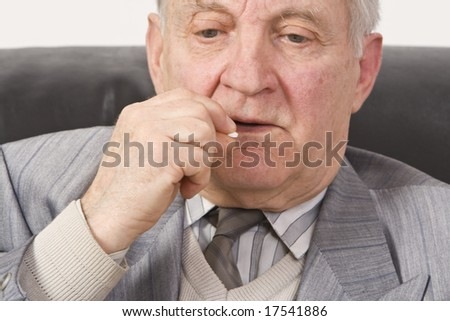 Portrait of a senior man taking his medication. - stock photo