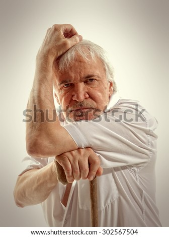 Portrait of a senior man thinking about something - stock photo