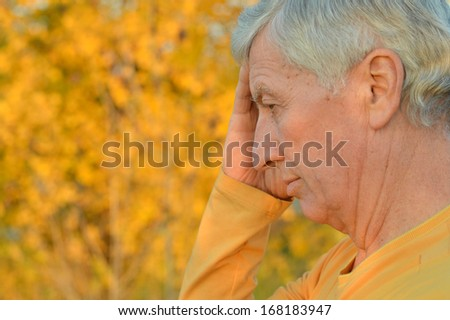 Portrait of a senior man thinking about something outdoors