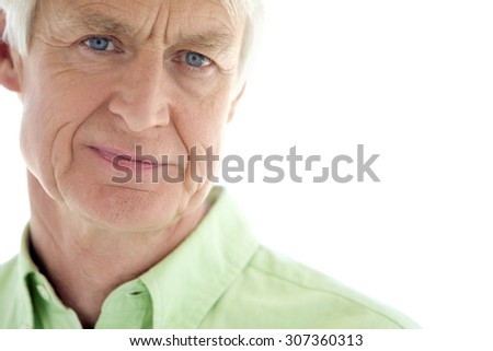Portrait of a senior man with copy space - isolated on white