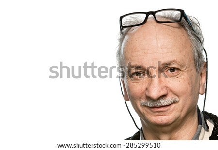 Portrait of a senior man with glasses  and copy-space - stock photo