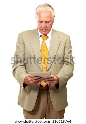 Portrait Of A Senior Man, Working On A Laptop On White Background - stock photo